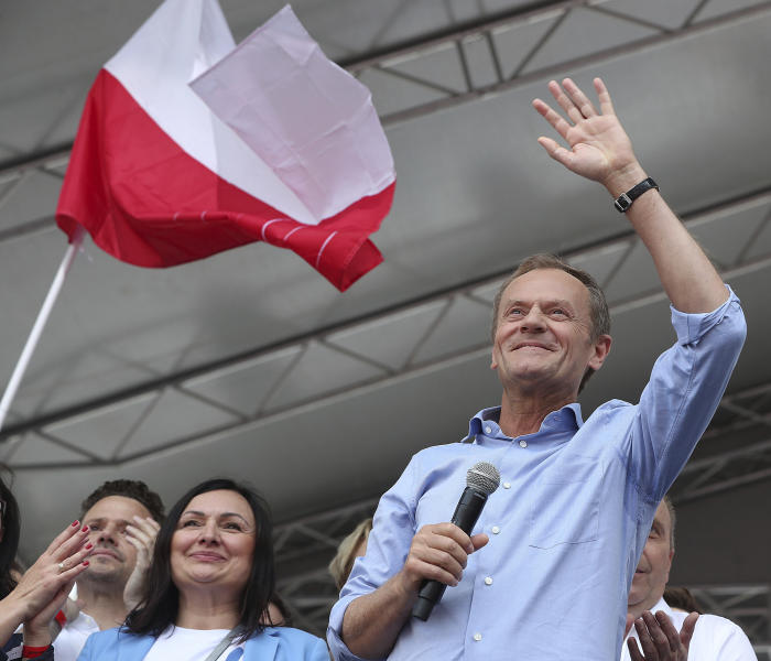 European Union Council President Donald Tusk leads a march celebrating Poland's 15 years in the EU and stressing the nation's attachment to the 28-member bloc ahead of May 26 key elections to the European Parliament, in Warsaw, Poland, Saturday, May 18, 2019.(AP Photo/Czarek Sokolowski)