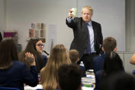 Britain's Prime Minister Boris Johnson visits Ruislip High School in his constituency of Uxbridge, west London, Monday Sept. 28, 2020. Lawmakers and scientists have criticized Johnson's Conservative government for problems with the national test-and-trace program that was supposed to help control the spread of the disease and reduce the need for limits on social interactions. (Stefan Rouseau/PA via AP)