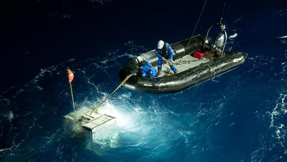A navigational lander is retrieved in a risky operation after his journey to the Challenger Deep. - Credit: Michael Dubno