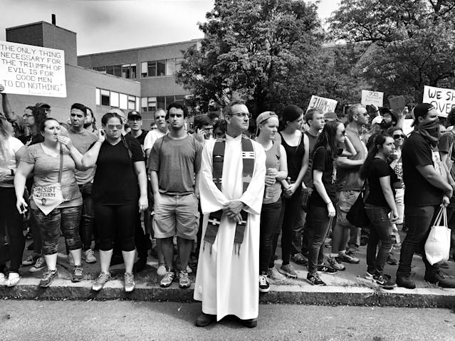 "<p>A member of the clergy stands near the front line of a counterprotest against a ""free speech"" rally staged by conservative activists Aug. 19 in Boston (Photo: Holly Bailey/Yahoo News) </p>"