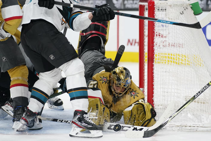 Vegas Golden Knights goaltender Marc-Andre Fleury (29) makes a save against the San Jose Sharks during the third period of an NHL hockey game Wednesday, April 21, 2021, in Las Vegas. (AP Photo/John Locher)