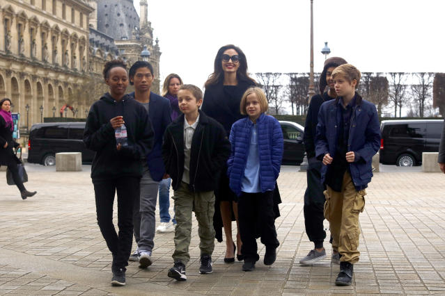 When Jolie worked in London this summer, Pitt went along to spend time with the children (pictured: Zahara, Pax, Knox, Vivienne, Maddox, and Shiloh with their mother in 2017). (Photo: Mehdi Taamallah/Nurphoto)