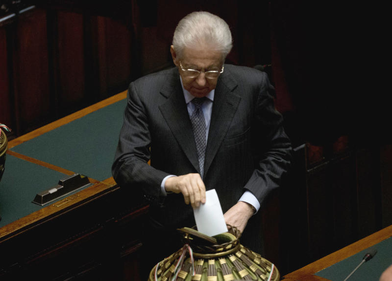 Italian caretaker Premier Mario Monti cast his vote for a new president whose first job will be to seek the formation of a new government after inconclusive elections, in Rome Thursday, April 18, 2013. Political parties sparred over suitable candidates for the post being vacated by Giorgio Napolitano ahead of the Thursday vote, reflecting divisions that they have been unable to overcome in the more than 50 days since the Feb. 24-25 elections. Napolitano's term expires next month. (AP Photo/Alessandra Tarantino)
