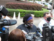Thea Brooks speaks with reporters Tuesday, May 11, 2021, following a court hearing for three men charged with federal hate crimes in the slaying of her nephew, Ahmaud Arbery, in Brunswick, Ga. Justice Department prosecutors say Arbery was targeted because he was Black when he was chased and fatally shot by white men who saw him running in their neighborhood on Feb. 23, 2020. All three defendants pleaded not guilty to hate crime charges before a U.S. magistrate judge. They are also charged with murder in a Georgia state court. (AP Photo/Russ Bynum)
