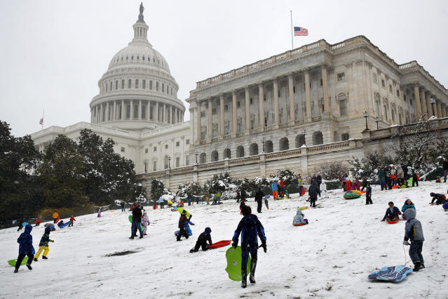<p>Families sled down a hill on the House side of the Capitol in Washington, Wednesday, March 21, 2018, during a spring snowstorm. (Photo: Jacquelyn Martin/AP) </p>