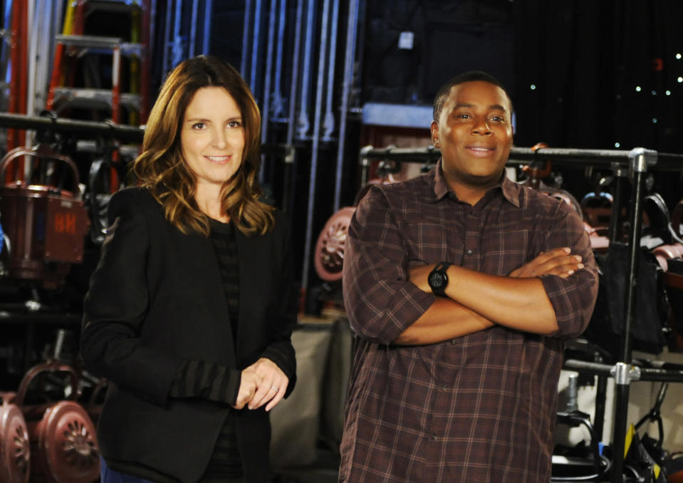 """This Sept. 24, 2013 photo released by NBC shows Tina Fey, left, and Kenan Thompson on the set of """"Saturday Night Live,"""" in New York. Fey, a former cast member, will host the season opener of the popular late night sketch comedy show on Sept. 28. (AP Photo/NBC, Dana Edelson)"""