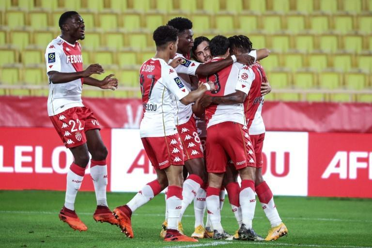 Monaco forward Kevin Volland (C) celebrates his first goals in Ligue 1