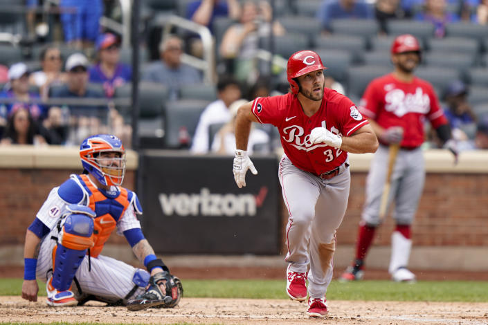 New York Mets catcher Tomas Nido, left, and Cincinnati Reds' Max Schrock (32) watch Schrock's home run during the fourth inning of a baseball game, Sunday, Aug. 1, 2021, in New York. (AP Photo/Corey Sipkin)