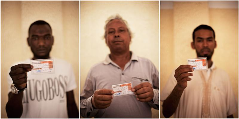 This combo image of three photographs shows Libyan men holding their elections ID at a polling station in Tripoli, Libya, Saturday, July 7, 2012. Jubilant Libyan voters marked a major step toward democracy after decades of erratic one-man rule, casting their ballots Saturday in the first parliamentary election after last year's overthrow and killing of longtime leader Moammar Gadhafi. But the joy was tempered by boycott calls, the burning of ballots and other violence in the country's restive east. (AP Photo/Manu Brabo)