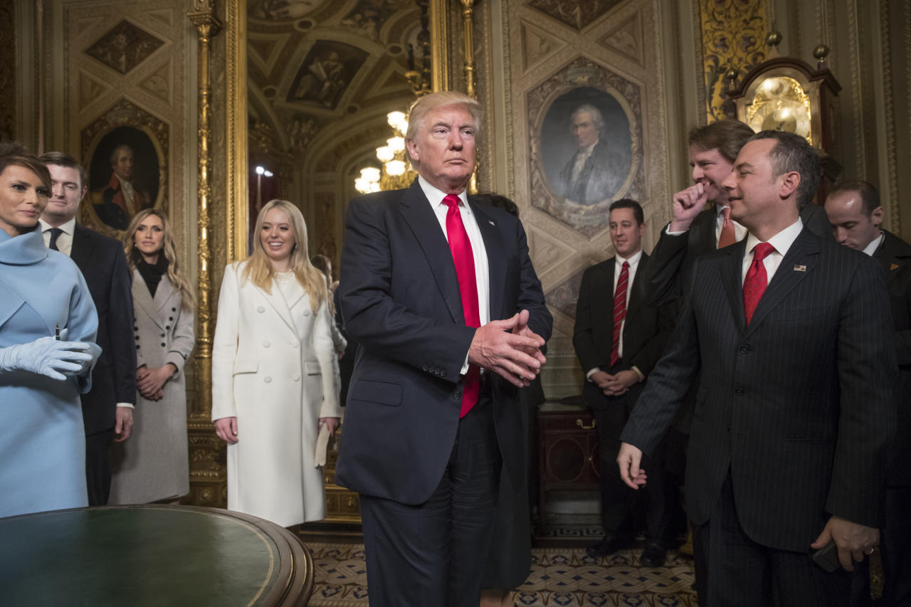 <p> President Donald Trump leaves the President's Room of the Senate on Capitol Hill in Washington, Friday, Jan. 20, 2107, after he formally signed his cabinet nominations into law. He is joined at far left by his wife, first lady Melania Trump and daughter Tiffany Trump. At far right is Chief of Staff Reince Priebus, with White House counsel Donald McGahn, second from right. (AP Photo/J. Scott Applewhite, Pool) </p>