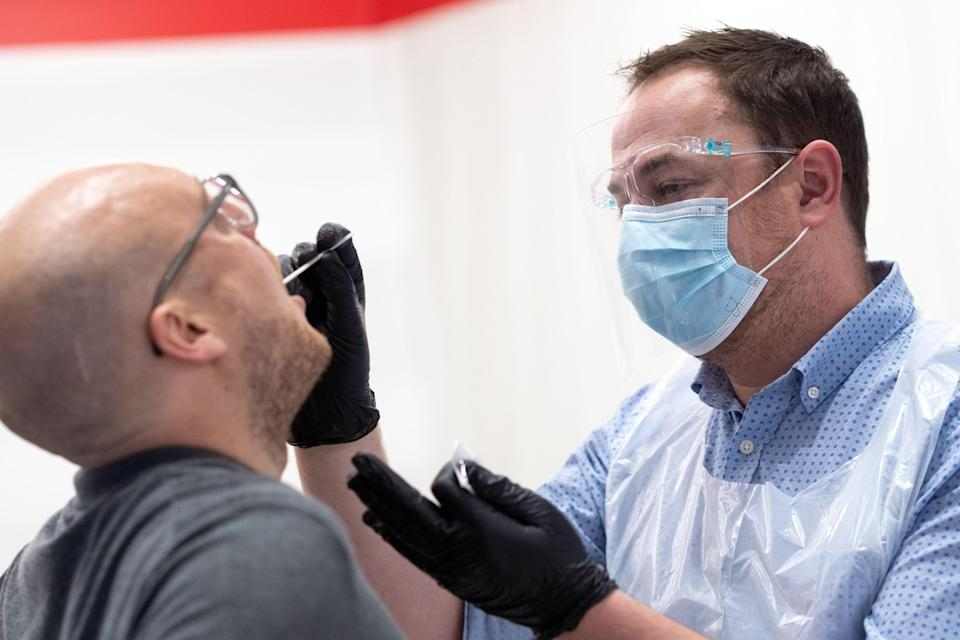 A coronavirus test being conducted (LHR AIRPORTS LIMITED/AFP via Get)