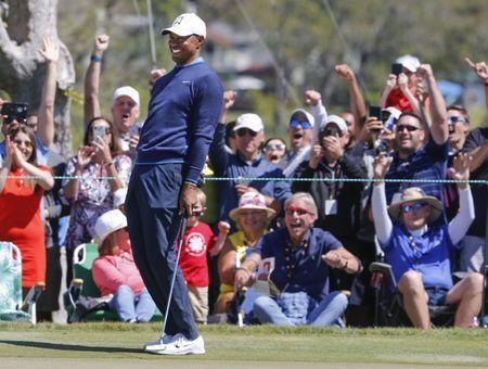 Mar 15, 2018; Orlando, FL, USA; Tiger Woods reacts to making a long putt on the seventh green during the first round of the Arnold Palmer Invitational golf tournament at Bay Hill Club & Lodge . Mandatory Credit: Reinhold Matay-USA TODAY Sports