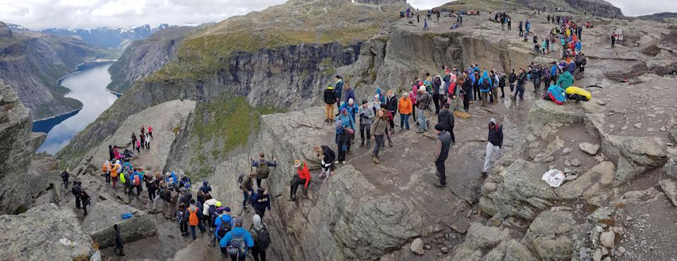 The reality of the rock, where people queue for up to six hours to get a photo (Trolltunga Adventures / Caters News)