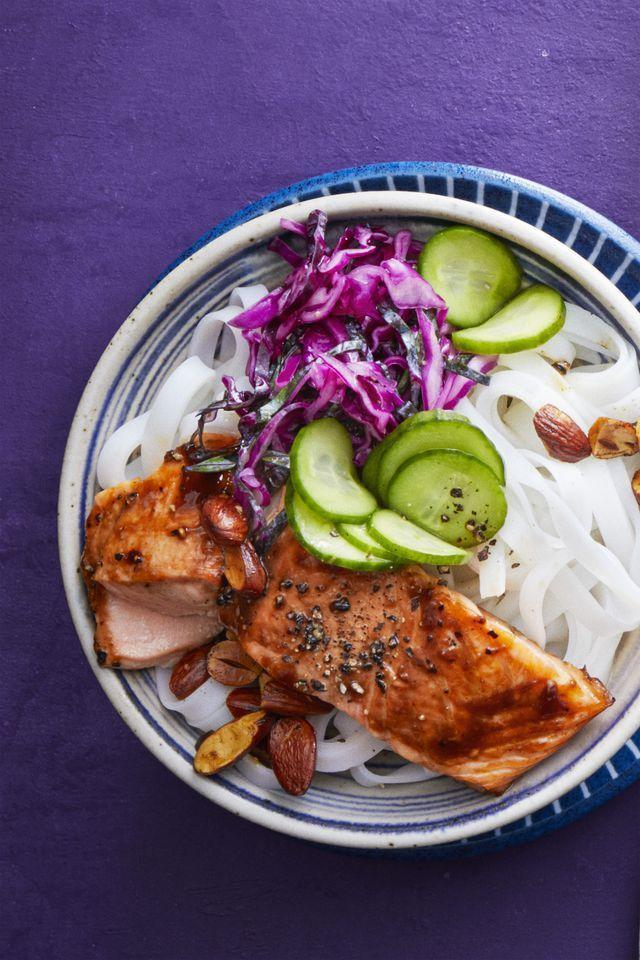 """<p>Become a meal prep pro: Cook all the components of this bowl on a Sunday to stash in the fridge (separately, in tightly sealed containers) for up to three days. Then, simply assemble night-of for a fast, fresh dinner.</p><p><em><a href=""""https://www.womansday.com/food-recipes/food-drinks/recipes/a61043/salmon-noodle-bowl-recipe/"""" rel=""""nofollow noopener"""" target=""""_blank"""" data-ylk=""""slk:Get the recipe for Salmon Noodle Bowl"""" class=""""link rapid-noclick-resp"""">Get the recipe for Salmon Noodle Bowl</a></em></p>"""