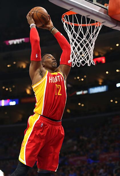 LOS ANGELES, CA - MAY 10:  Dwight Howard #12 of the Houston Rockets dunks against the Los Angeles Clippers during Game Four of the Western Conference semifinals of the 2015 NBA Playoffs at Staples Center on May 10, 2015 in Los Angeles, California.  NOTE TO USER: User expressly acknowledges and agrees that, by downloading and or using this photograph, User is consenting to the terms and conditions of the Getty Images License Agreement.  (Photo by Stephen Dunn/Getty Images)