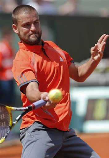 Russia's Mikhail Youzhny returns the ball to to Spain's David Ferrer during their third round match in the French Open tennis tournament at the Roland Garros stadium in Paris, Saturday, June 2, 2012. (AP Photo/Bernat Armangue)