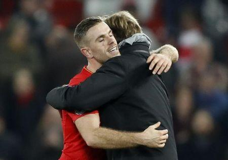 Britain Soccer Football - Liverpool v Tottenham Hotspur - Premier League - Anfield - 11/2/17 Liverpool manager Juergen Klopp celebrates wih Jordan Henderson after the match Action Images via Reuters / Carl Recine Livepic