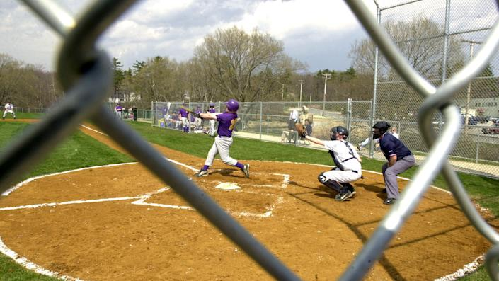 Did a group of parents move their kids school's softball diamond fence back without permission? (Getty)