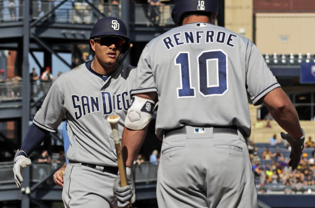 San Diego Padres' Manny Machado, left, celebrates his solo home run off Pittsburgh Pirates starting pitcher Chris Archer with Hunter Renfroe (10) during the fourth inning of a baseball game in Pittsburgh, Saturday, June 22, 2019. (AP Photo/Gene J. Puskar)