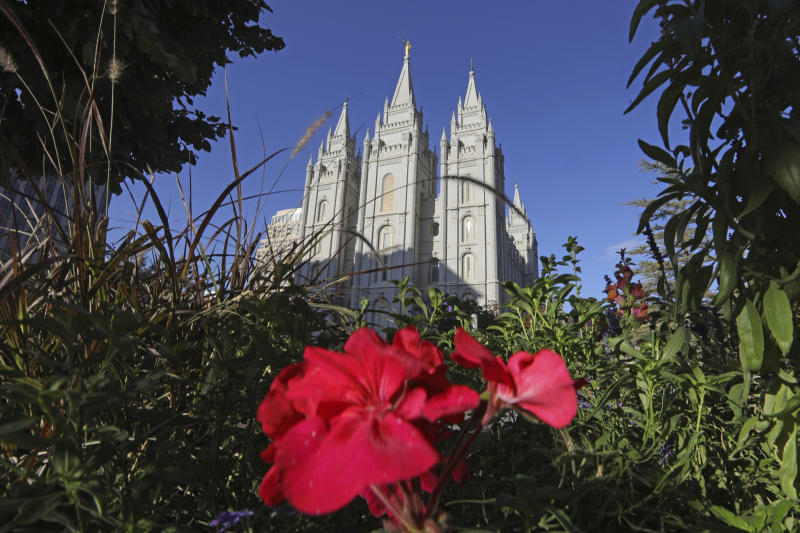 FILE - This Oct. 4, 2019, file photo, shows the Salt Lake Temple at Temple Square in Salt Lake City. The Church of Jesus Christ of Latter-day Saints has postponed a key meeting of top global leaders scheduled for April 1-2 because of the spread of the coronavirus around the world. The faith is also discouraging members from traveling from outside the United States for a twice-yearly conference set for the weekend of April 4-5 in Salt Lake City, the religion said in a news release Thursday, Feb. 27, 2020. (AP Photo/Rick Bowmer, File)