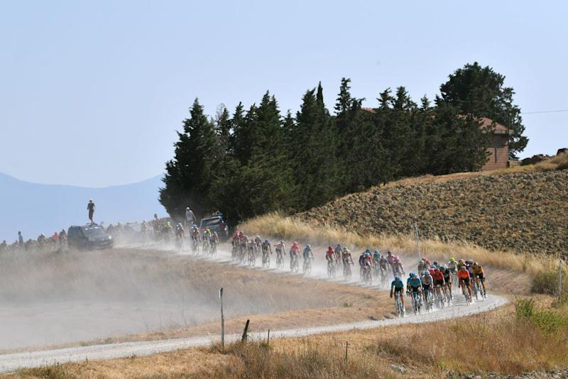 SIENA ITALY AUGUST 01 Peloton Dust Gravel Strokes Landscape during the Eroica 14th Strade Bianche 2020 Men a 184km race from Siena to SienaPiazza del Campo StradeBianche on August 01 2020 in Siena Italy Photo by Tim de WaeleGetty Images