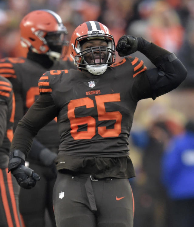 Cleveland Browns defensive tackle Larry Ogunjobi (65) celebrates a sack during the second half of an NFL football game against the Cincinnati Bengals, Sunday, Dec. 23, 2018, in Cleveland. (AP Photo/David Richard)