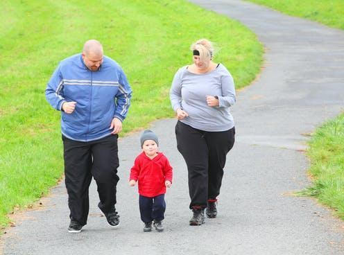 """<span class=""""caption"""">One of the government's strategies is to promote increased physical activity.</span> <span class=""""attribution""""><a class=""""link rapid-noclick-resp"""" href=""""https://www.shutterstock.com/image-photo/overweight-parents-her-son-running-together-227455102"""" rel=""""nofollow noopener"""" target=""""_blank"""" data-ylk=""""slk:Kletr/ Shutterstock"""">Kletr/ Shutterstock</a></span>"""