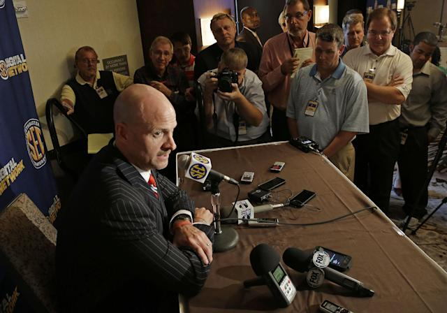 Mississippi coach Andy Kennedy talks with reporters at the Southeastern Conference NCAA college basketball media day in Birmingham, Ala., Wednesday, Oct. 16, 2013. (AP Photo/Dave Martin)