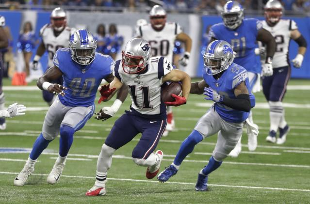 New England WR Julian Edelman, center, left Friday night's game against the Detroit Lions during the Patriots' opening possession. (AP)