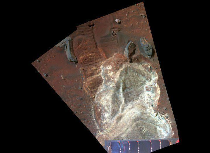 """In late 2008, Spirit got bogged down in the soft salty soils around an ancient volcanic feature called Home Plate. This Pancam sol 1933 (June 10, 2009) false-color mosaic reveals the lovely variety of colors and textures in the soils where the rover is currently still stuck. <em>From """"Postcards from Mars"""" by Jim Bell; Photo credit: NASA/JPL/Cornell University</em>"""