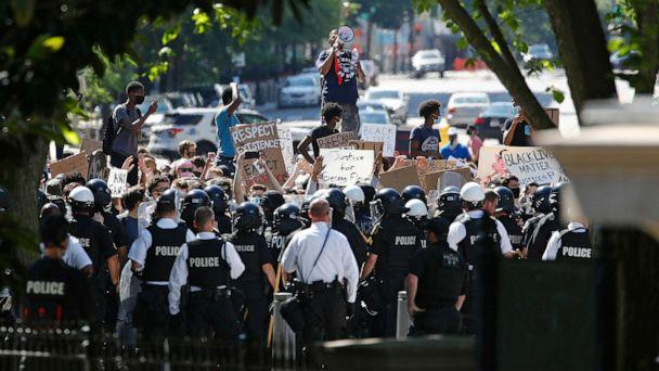 PHOTO: Protesters gather in front of a line of uniformed U.S. Secret Service as demonstrators gather to protest the death of George Floyd, near the White House, Saturday, May 30, 2020, in Washington.  (Patrick Semansky/AP)