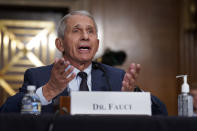 """FILE - In this July 20, 2021 file photo, top infectious disease expert Dr. Anthony Fauci responds to accusations by Sen. Rand Paul, R-Ky., as he testifies before the Senate Health, Education, Labor, and Pensions Committee, on Capitol Hill in Washington. Fauci says on Thursday, Aug. 12, an additional COVID-19 booster shot will be recommended for previously vaccinated people with weakened immune systems. He told NBC's """"Today"""" show he expects the booster recommendation to come """"imminently."""" (AP Photo/J. Scott Applewhite, Pool)"""