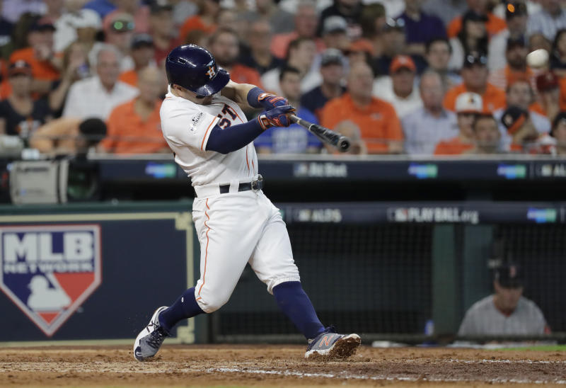 Houston Astros' Jose Altuve hits a solo home run against Boston Red Sox starting pitcher Chris Sale during the fifth inning in Game 1 of a baseball American League Division Series, Thursday, Oct. 5, 2017, in Houston. (AP Photo/David J. Phillip)