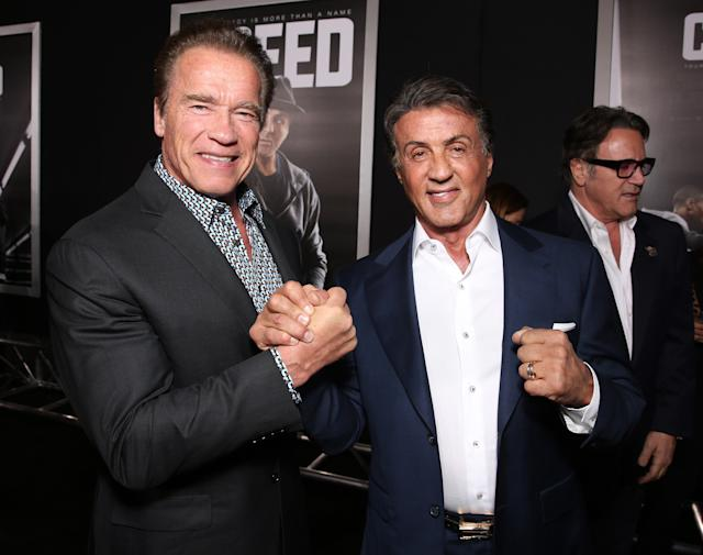 Old pals Arnold Schwarzenegger and Sylvester Stallone at the premiere of <em>Creed</em>on Nov. 19, 2015. (Photo: Todd Williamson/Getty Images)