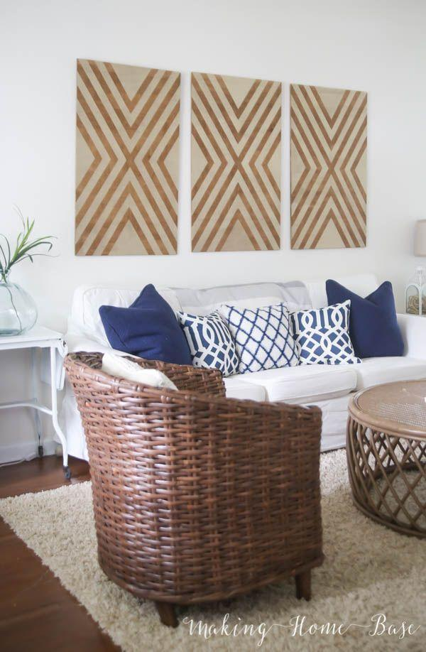 "<p>Oversized and ideal to hang over a couch, this geometric wall art can be made using plywood and spray paint. It's just the contemporary accent a living room needs. </p><p><strong>Get the tutorial at <a href=""https://www.makinghomebase.com/diy-oversized-wall-art/"" rel=""nofollow noopener"" target=""_blank"" data-ylk=""slk:Making Home Base"" class=""link rapid-noclick-resp"">Making Home Base</a>.</strong></p><p><a class=""link rapid-noclick-resp"" href=""https://www.amazon.com/3M-9019-General-Sandpaper-Assorted/dp/B00004Z47W/?tag=syn-yahoo-20&ascsubtag=%5Bartid%7C10050.g.31153820%5Bsrc%7Cyahoo-us"" rel=""nofollow noopener"" target=""_blank"" data-ylk=""slk:SHOP SANDPAPER"">SHOP SANDPAPER</a></p>"