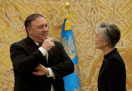 FILE PHOTO: U.S. Secretary of State Mike Pompeo speaks with South Korean Foreign Minister Kang Kyung-wha at the presidential Blue House in Seoul