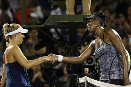 Mar 29, 2017; Miami, FL, USA; Venus Williams of the United States (R) shakes hands with Angelique Kerber of Germany (L) on day nine of the 2017 Miami Open at Crandon Park Tennis Center. Williams won 7-5, 6-3. Geoff Burke-USA TODAY Sports