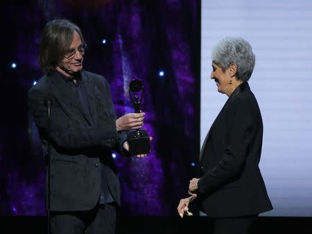 32nd Annual Rock & Roll Hall of Fame Induction Ceremony - Show – New York City, U.S., 07/04/2017 – Presenter Jackson Browne with inductee Joan Baez. REUTERS/Lucas Jackson