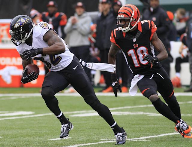 Baltimore Ravens strong safety James Ihedigbo (32) runs away from Cincinnati Bengals wide receiver A.J. Green (18) after intercepting a pass in the first half of an NFL football game on Sunday, Dec. 29, 2013, in Cincinnati. (AP Photo/Tom Uhlman)
