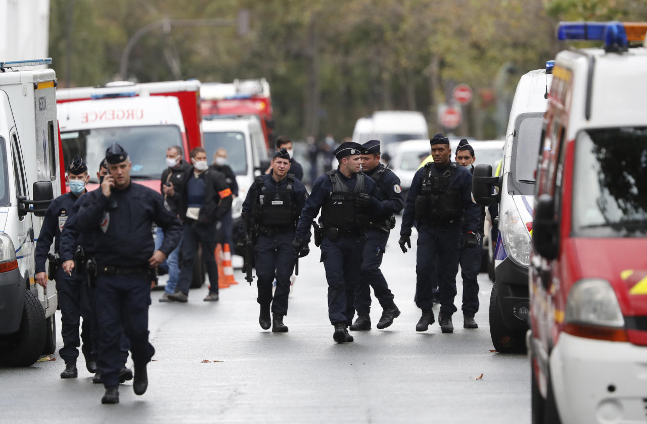 "French police officers patrol after four people have been wounded in a knife attack near the former offices of satirical newspaper Charlie Hebdo, Friday Sept. 25, 2020 in Paris. A police official said officers are ""actively hunting"" for the perpetrators and have cordoned off the area including the former Charlie Hebdo offices after a suspect package was noticed nearby. Islamic extremists attacked the offices in 2015, killing 12 people. (AP Photo/Thibault Camus)"