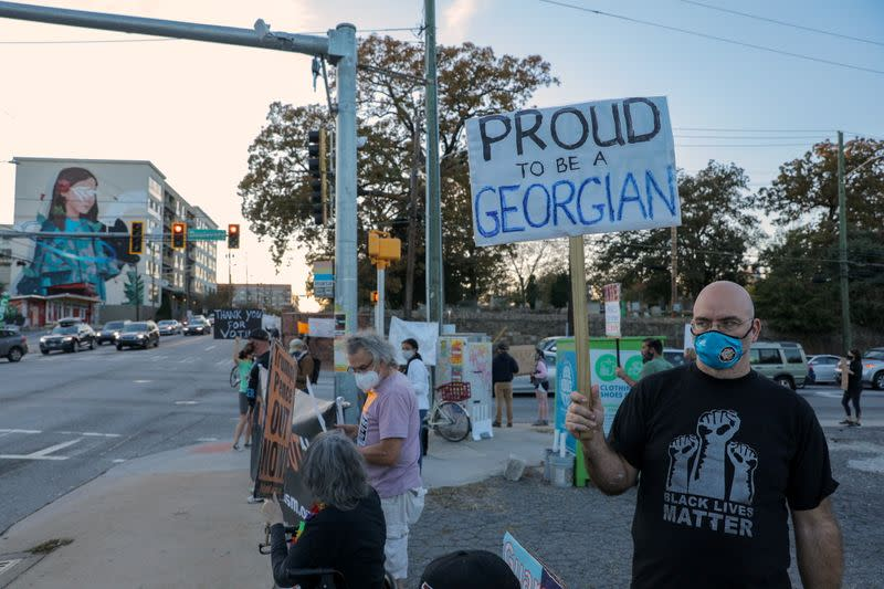 Protesters against U.S. President Donald Trump demonstrate at an intersection near Downtown in Atlanta