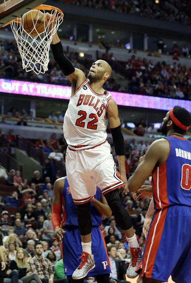 Chicago Bulls forward Taj Gibson (22) dunks against the during the second half of an NBA basketball game against the Detroit Pistons in Chicago on Friday, April 11, 2014. The Bulls won 106-98. (AP Photo/Nam Y. Huh)