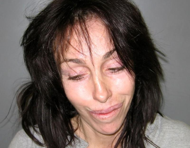 FILE - In this Feb. 7, 2008 file photo released by the Nye County Sheriff's Office, former Hollywood madam Heidi Fleiss is shown in a booking photo released in Pahrump, Nev. after she was arrested on charges of illegal possession of prescription drugs and driving under the influence. Authorities say Fleiss was arrested Oct. 22, 2013, in Nevada after deputies found her driving under the influence of marijuana. (AP Photo/via Nye County Sheriff's Office (AP Photo/Nye County Sheriff's Office, File)