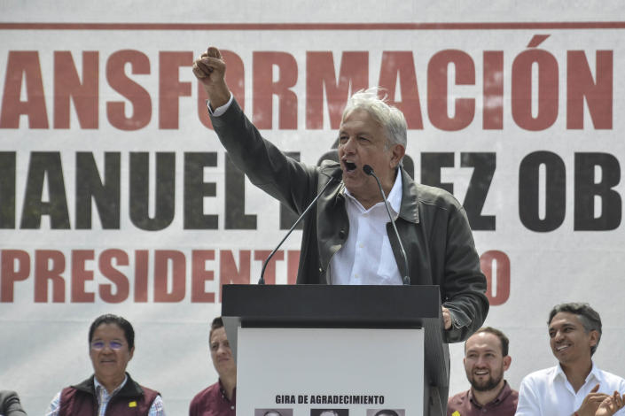 Mexico's President-elect Andres Manuel Lopez Obrador speaks at a rally commemorating the 50th anniversary of a bloody reprisal against students, at the Tlatelolco Plaza in Mexico City, Saturday, Sept. 29, 2018. Lopez Obrador vowed Saturday to never use military force against civilians. Troops fired on a peaceful demonstration at the plaza on Oct. 2, 1968, killing as many as 300 people at a time when leftist student movements were taking root throughout Latin America. (AP Photo/Christian Palma)