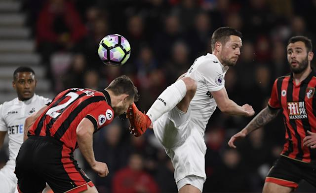 <p>Swansea City's Gylfi Sigurdsson in action with Bournemouth's Simon Francis </p>