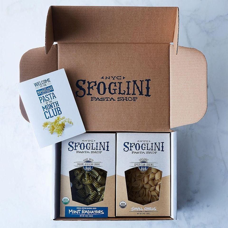"""<p><strong>Sfoglini </strong></p><p>food52.com</p><p><strong>$65.00</strong></p><p><a href=""""https://go.redirectingat.com?id=74968X1596630&url=https%3A%2F%2Ffood52.com%2Fshop%2Fproducts%2F4066-sfoglini-seasonal-pasta-subscription&sref=https%3A%2F%2Fwww.bestproducts.com%2Feats%2Ffood%2Fg2177%2Ffood-gift-baskets-ideas%2F"""" rel=""""nofollow noopener"""" target=""""_blank"""" data-ylk=""""slk:Shop Now"""" class=""""link rapid-noclick-resp"""">Shop Now</a></p><p>If you're as <a href=""""https://www.bestproducts.com/eats/food/g2014/best-boxed-pasta/"""" rel=""""nofollow noopener"""" target=""""_blank"""" data-ylk=""""slk:pasta-obsessed"""" class=""""link rapid-noclick-resp"""">pasta-obsessed</a> as we are, there's no better gift to receive than a pasta subscription box, which ensures a constant carb flow to your front door.</p><p>This genius pasta subscription from New York-based pasta brand Sfoglini lets you choose between 3- or 6-month increments, and each month's box includes two 16-ounce boxes of seasonal handmade pasta. </p><p>For serious pasta lovers, this just might be the best riff on a food gift basket ever created.</p>"""