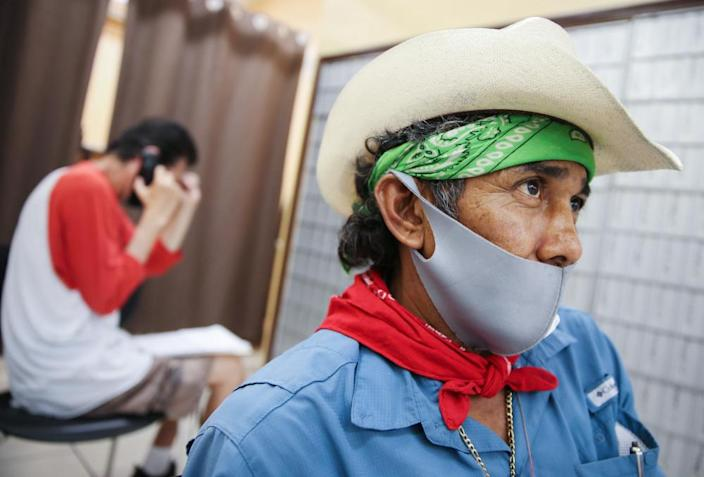 Faustino waits after filling out unemployment forms in a bookkeeping shop in Imperial county in California.