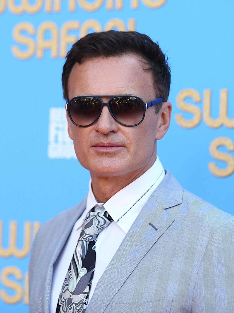 Julian McMahon (here looking suave at the Swinging Safari premiere) was totally down to share his thoughts on swinging. Source: Getty