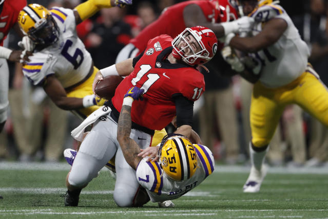 "LSU safety <a class=""link rapid-noclick-resp"" href=""/ncaaf/players/275266/"" data-ylk=""slk:Grant Delpit"">Grant Delpit</a> (7) sacks Georgia quarterback <a class=""link rapid-noclick-resp"" href=""/ncaaf/players/275086/"" data-ylk=""slk:Jake Fromm"">Jake Fromm</a> (11) during the first half of the SEC championship game. Fromm was injured on the play. (AP Photo/John Bazemore)"