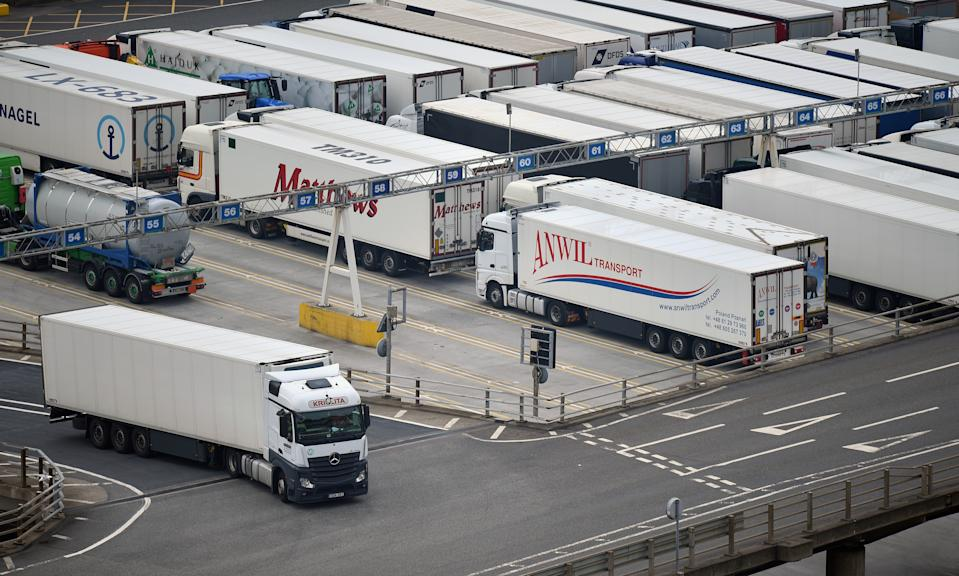A Freight lorry (L) prepares to leave the Port of Dover after disembarking from a cross-channel ferry, in Dover on the south coast of England on June 12, 2020. - Britain will apply